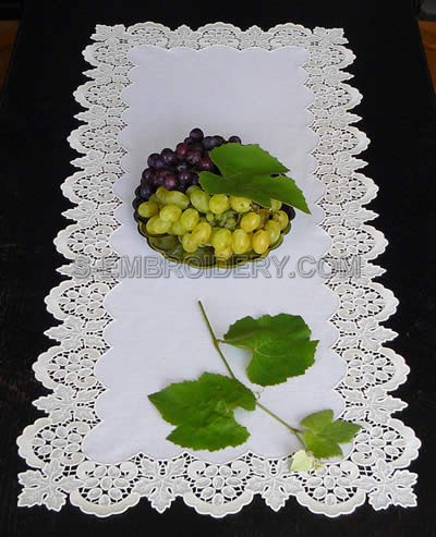 Table runner with freestanding lace grapes border