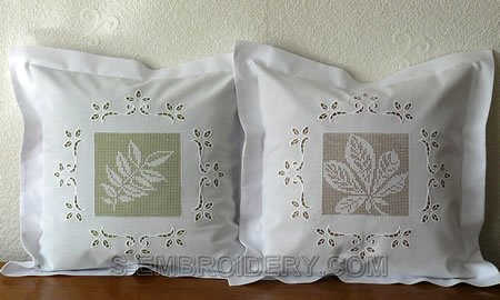 Pillows decorated with crochet squares and cutwork lace embroidery