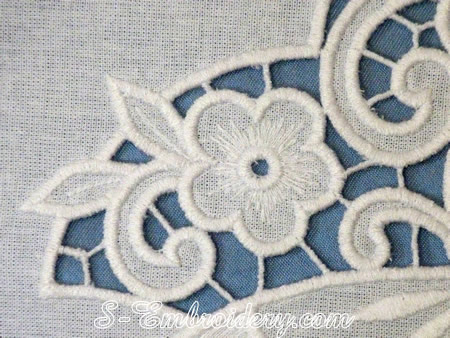Butterfly cutwork lace machine embroidery design - close-up image