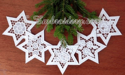 10631 Free standing lace and cutwork star ornaments