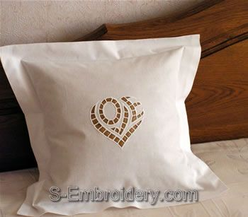 Cutwork Lace Heart Embroidery design used as pillow decoration