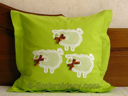 Pillow case with freestanding lace lamb ornaments