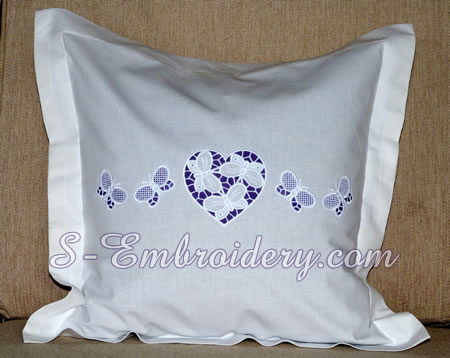 A pillow case with hearts cutwork embroidery