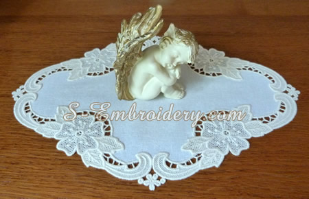Free standing lace floral doily with an angel