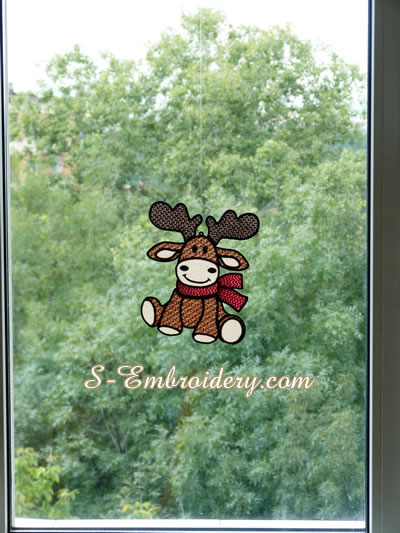 Free standing lace Reindeer ornament on a window